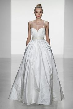 Crushing on this gowns corseted bodice and simple skirt