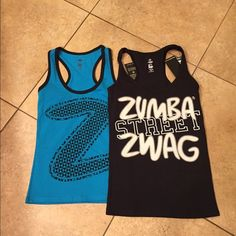 Zumba NWT bundle if 2 size XS NWT bundle includes a blue race back tank size XS. A black race back tank size XS. Tags attached no flaws Zumba Tops