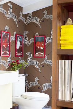 Interesting combination- Scalamandre zebra wallpaper in safari brown, red framed art work, Colorfully Eclectic Family Home Zebra Wallpaper, Bungalow, Interior And Exterior, Interior Design, Amazing Bathrooms, Bathroom Inspiration, Home Accents, Decorating Your Home, Luxury Homes