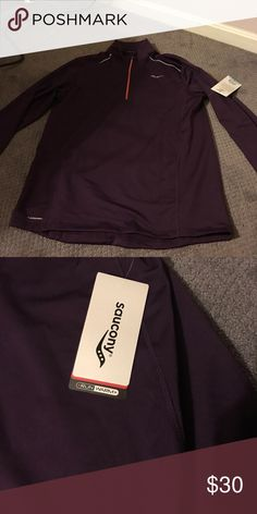 Saucony purple sweatshirt Running sweatshirt. Purple with orange zipper and silver details. Tag still on. Brand new never worn. Marketed for men but I am a woman and it works on women as well. Saucony Sweaters Zip Up