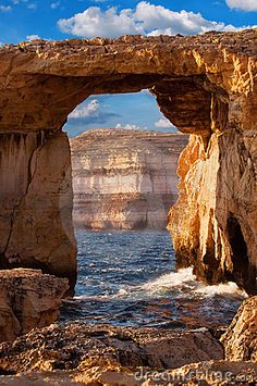 Azure window, natural stone arch by Dwejra cliffs at western  Gozo island, Malta