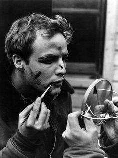 Marlon Brando applying his make-up on the set of On the Waterfront (1954, dir. Elia Kazan)