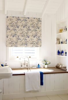Cream and natural shades of wood panelling creates a lovely British heritage inspired look. Add small hints of colour, floral patterns and plains are perfect for this. Our Almond Blossom China Blue Roman blind is perfect to add a hit of floral into your room.