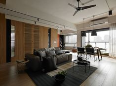 Awork Design Studio designed an apartment in Taiwan with an open floor plan with lots of natural light, along with places for the children to play.