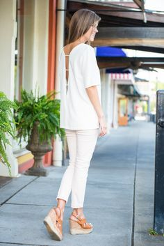 This blouse practically goes with every little thing!! It' solid white coloring and simple yet adorable details make it a dream to pair with so many bottoms! Plus you can add any color or style necklace you want with this beauty!