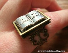Book Lover's Locket Ring by EbraryTree on Etsy. They need to stock up on these, because I feel like they'd be a huge seller.