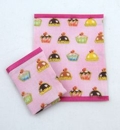 Miniature cupcake teatowels edged with pink satin ribbon.