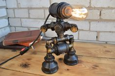 robot lamp with a heart inside, in an industrial style with steampunk elements and vintage latches by DesignerLight on Etsy Rustic Floor Lamps, Industrial Floor Lamps, Industrial Ceiling Lights, Rustic Lamps, Rustic Lighting, Industrial Style, Industrial Pipe, Table Lamps For Bedroom, Steampunk Lamp