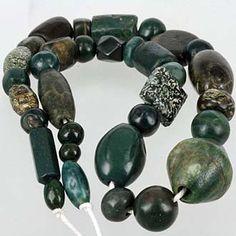 Mixed stone beads including serpentine, nephrite jade & granite - well worn, mostly Islamic world in origin.