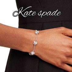 Authentic Kate spade lady marmalade bracelet Authentic Kate spade lady marmalade.                  Color: clear silver.                                                   Silver chain scattered crystal balls gold tone hardware. Lobster clasped closure. Comes with Kate spade dust bag kate spade Jewelry Bracelets