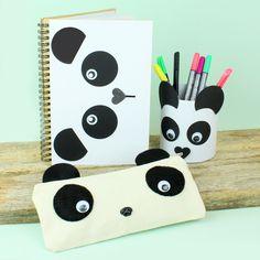 Pahvikantinen muistikirja, pahvipurkki ja penaali on koristeltu vekkuleiksi pandoiksi.