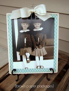 Wooden cliboards with pictures of Toby and me to decorate the reception room... Then give the clipboards as favors?