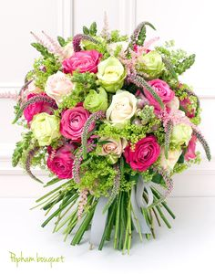 Roses, snaps, viburnum, loosestrife, astillbe and more in a gorgeous hand-tied bouquet.