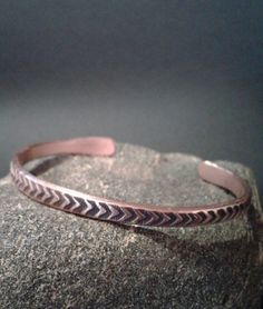 Ultra thin solid Copper cuff for him ... your special guy ... heavy gauge raw copper ... nice weight, not too heavy ... in a rustic native arrow design  I gave one to my bro-in-law for his birthday who commented bad ass. I think he liked it muchly! ha  I hand cut, hand stamp, hand oxidize, hand shape in an oval, and hand polish ... one at a time ... in my small studio with 2 rescue dogs: Mason and Spot. WIDTH: 1/4 SIZE: made to order - please select your size.  Ready to ship within 2 day...
