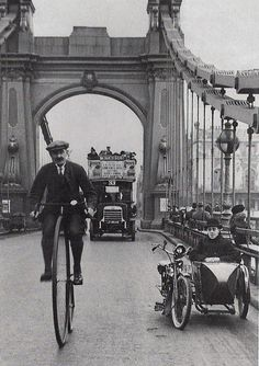 Hammersmith Bridge-London 1900. Love that little car or whatever they called it. How about the bus in the background too!!
