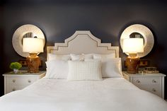 Headboard with nailhead trim, mirrors above nightstands