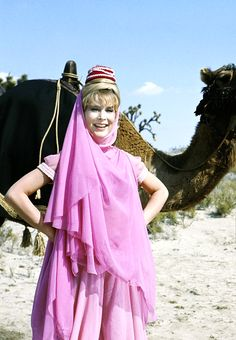 """Barbara Eden on the set of I Dream of Jeannie, 1965 """" While filming season Barbara Eden was pregnant with her only son, Matthew Ansara. Her pregnancy was disguised by filming her in close-up or. Sidney Sheldon, Barbara Eden, I Dream Of Jeannie, Beautiful Dark Art, Most Beautiful, Matthew Ansara, Aladdin Costume, Arabian Princess, Agnes Moorehead"""