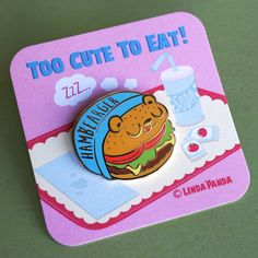 Add some adorable flare to your outfits or your pin board with the Too Cute To Eat collection brought to you by Linda Panda! The Hambearger Lapel Pin would love to join you for all your delicious burger endeavors! Munch Munch Rawr! Details: - 1 hard enamel lapel pin - rubber backing - comes with cute scenic backer card - listing is for one pin Enjoy