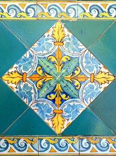 Barcelona... like these on the diagonal and combination of pattern, plain and border tile.  Maybe make using softer/distressed hues for bar top so terra cotta shows through.