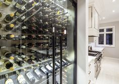 Modern Custom Reach In Wine Cellar Featuring The Cable Wine System  Www.cablewinesystems.com