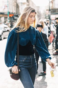 Don't believe us? See for yourself the black-and-navy outfits that prove a darker color palette can still be so chic.