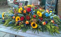 6 ft Colourful coffin spray created by Flowers by Juliette