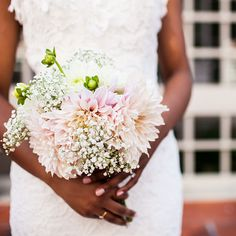 """Brides.com: A Classic Summer Wedding in Washington, D.C.. The bride describes her bouquet—a mix of pastel pink dahlias and white baby's breath—as """"simple and romantic. I also didn't want anything too big,"""" she says. """"I wanted the bouquet to complement my dress but not be a distraction."""""""