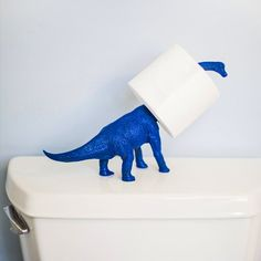 A Plastic Dinosaur + Some Spray Paint = a Fun Toilet Paper Holder for a little boys dinosaur bathroom!