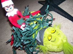 Elf on the shelf idea - elf ties up grinch with christmas lights.