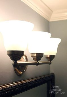 how to replace lighting fixtures. I need to get rid of the horrible Hollywood strip light fixture in the bathroom Vanity Light Fixtures, Bathroom Fixtures, Bathroom Lighting, Bathrooms, Cabinet Lighting, Bathroom Flooring, Vanity Lighting, Replace Light Fixture, Diy Bathroom Vanity