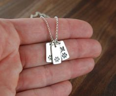 Sterling silver paw print tag with initial necklace in sterling silver, pet memorial, cat paw, dog paw, cat jewelry, dog jewelry, pets on Etsy, $25.00