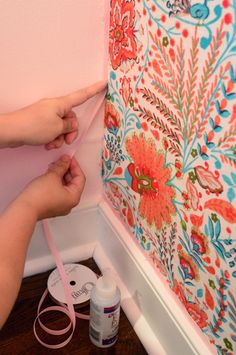 Wallflowers (aka: How To Cover A Wall With Fabric) What a cute idea! I want to try it on one of Alexis's walls!
