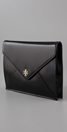 Tory Burch Envelope Clutch. obsessed. and same with the YSL version.