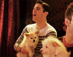 He's singing to a puppy...I can't, I just can't...