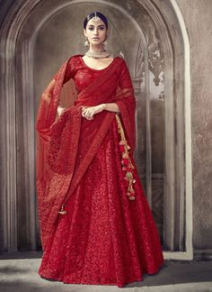 This red carpet worthy lehenga is perfect for those upcoming special occasions. Featuring a net lehenga in red with poly shantoon lining is designed with resham, zari, stone, dori and patch border work. This circular lehenga is paired with a red semi-stit Lehenga Sari, Lehnga Dress, Lehenga Choli Online, Sabyasachi, Saree Blouse, Indian Bridal Outfits, Indian Bridal Lehenga, Indian Dresses, Vestidos