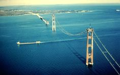 Aerial view of Mackinac Bridge construction and freighter