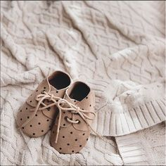 Soft sole, natural suede leather polka dot lace up baby shoes by Little Jones.