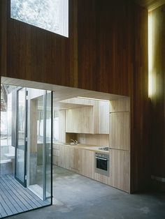 Adjaye Associates, Swarovski House. Timber Kitchen. Reconfigured terrace house (rear). Double-height space behind existing facade.