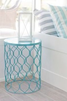 Dollar store trash bin, spray painted & used as a side table.