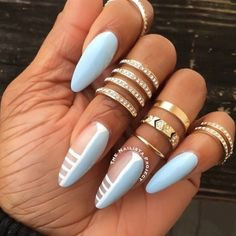baby blue stiletto nails with negative space nail art