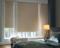 Lower for privacy and room darkening or raise for maximum light and view.  Designer Roller Shades are a beautiful bedroom window treatment either way. ♦ Hunter Douglas window treatments