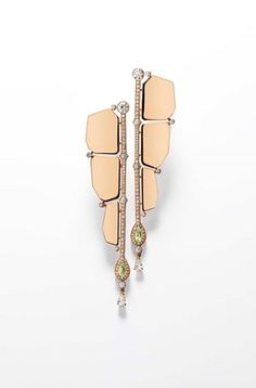 Hermès Niloticus Boutons d'Oreilles rose gold earrings featuring pear-shaped peridots and brilliant-cut diamonds.