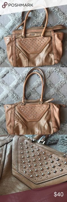 Guess handbag Beautiful pattern and color. Sassy studs on front. Great condition, just one spot on bottom shown in pics. Great purse for everyday casual or something a little more chic Guess Bags