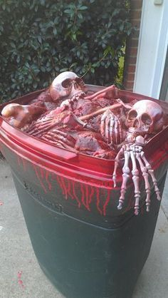 New barrel topper  1 - Old unused Rubbernaid trash can  1 - Bag-O-Bones  1 - Left over skeleton parts from Walgreens Skelly (after cutting neck down for use on butcher table)  3 - Cans of Great Foam  1 - Can of red spray paint  1 - Can of red mahogany laquer spray paint #diyhalloweendecorations