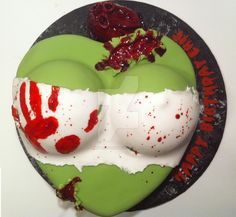 Zombie bust cake with cupcake heart. LOVED making this one