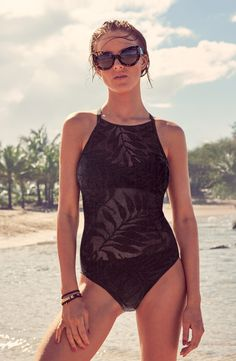 Look chic on the beach this summer in this sheer black one-piece swimsuit.