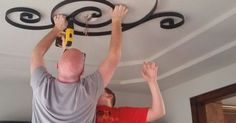 They hang a medallion on the ceiling. The reason? I LOVE this idea!