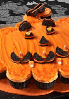 "Pumpkin Pull-Apart ""Cake"" -- Halloween is all about tricking and treating. Case in point: This yummy pumpkin-shape cake is actually a collection of cupcakes in disguise!"