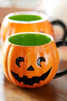 Carve out a space in your cupboard for a handcrafted Jack-o'-Lantern Mug from Pier 1. With its classic smiling expression and spotted handle, this glazed dolomite cup makes any drink frightfully refreshing. Might we suggest a pumpkin spice latte?