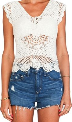This crochet top is an effortlessly sweet style that will lend a boho feel to your look. The bottom is decorated with beautiful floral motifs, while a bow at the neckline adds a girly touch. Crochet Crop Top, Sweet Style, Crochet Fashion, Revolve Clothing, Crochet Clothes, World Of Fashion, Free Crochet, Denim Skirt, Crochet Patterns
